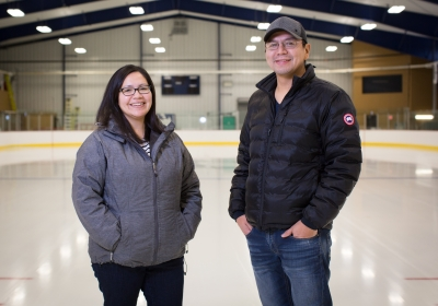 Tournament organizers, Shera Wesley and Chris Lawson, at the Lac Seul Arena. Not pictured is committee member Sol Mamakwa. Photo by Blue Earth Photography